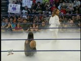 The Undertaker Bursts Through The Canvas And Glares At Shawn Michaels - Smackdown 27-03-09